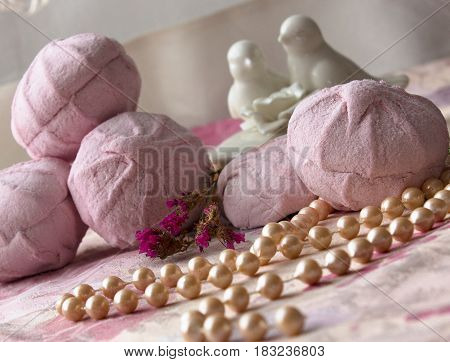 Pink marshmallow on pink cloth. zefir homemade