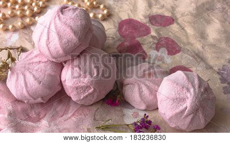 Pink marshmallow on pink cloth. top view