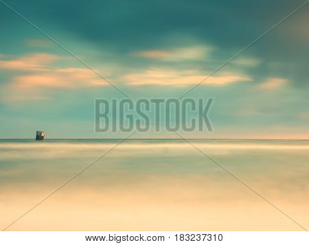 Concrete Block Island In Sea With Sitting Gull In  And Cormorant.