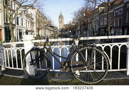 Vintage bike in front of canal in Delft