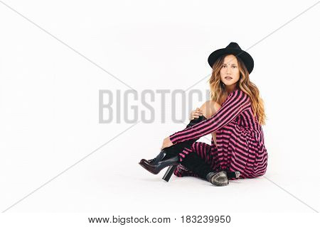 Full body portrait of young woman, isolated over white background.