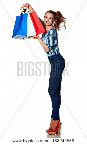 Happy Stylish Fashion-monger Showing Shopping Bags On White