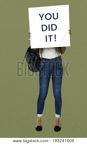 African girl holding you did it banner cover her face