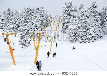 Winter resort with ski lift and ski tracks