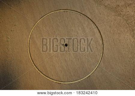 Wooden cornhole board DIY project with circular cut using hole saw