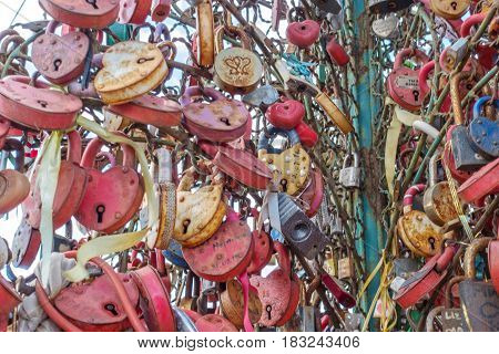 MOSCOW RUSSIA - March 23 2017: Tree with the locked wedding locks on the Bridge of Love.