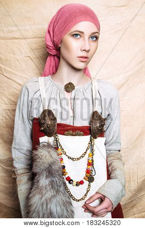 Portrait Of Slavic Women From The Past. Historical Reconstruction. National Vintage Clothing. Studio