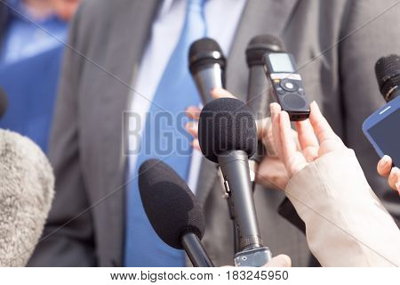 Journalists making media interview with businessperson or politician. Press conference. Journalism.