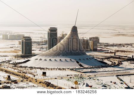 Top view of the shopping center Khan Shatyr in winter on a sunny day in Astana, Kazakhstan.