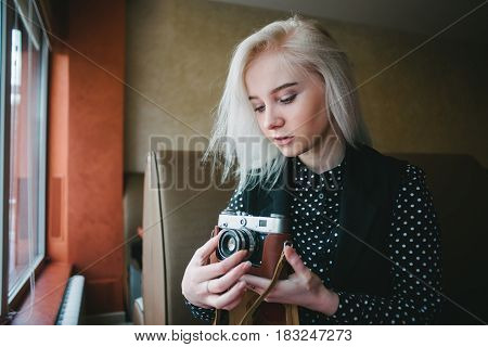 movement of photographer. portrait young woman in vintage style. Young beautiful woman hipster holding retro camera
