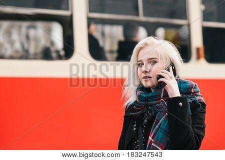 Woman making phone call at the underground platform