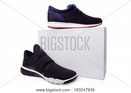 Mens Black Sport Shoes Near The White Box. Isolate On White.
