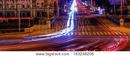 Night life of city roads bright traces leave cars very beautifully