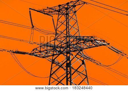 high-voltage power lines at orange sky . electricity distribution station .