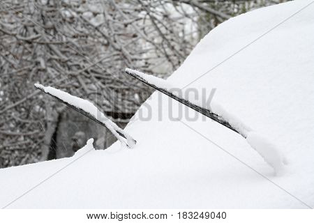 Car covered with snow. The snow is only visible a small part of the machine.