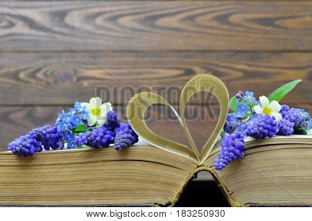 Happy Anniversary card with flowers and heart shaped book pages