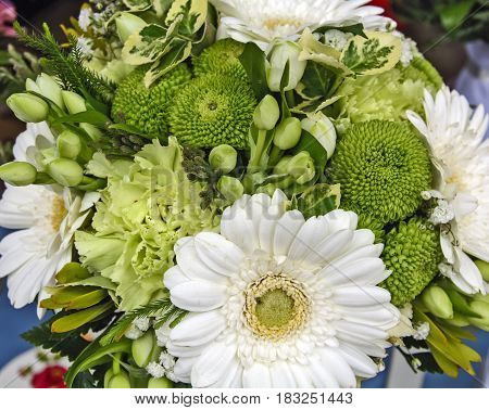 Beautiful fragrant bouquet of colorful flowers at the market waiting for customers.