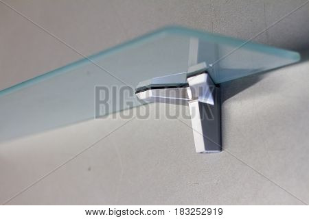 Mount for glass shelves or wood. Furniture accessories. Fasteners for furniture, shelves of different materials, different colors and shapes. The manufacture of furniture.