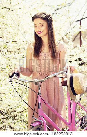 Spring Beauty. Portrait Of Young Beautiful Long-haired Girl Dressed In Pink Dress Standing With Retr