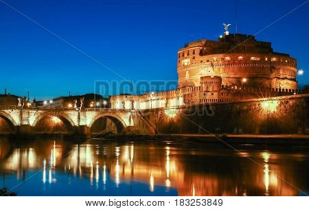 St.Angelo Bridge and Castle Sant'Angelo by night Rome Italy