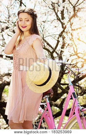 Spring Mood. Portrait Of Smiling Beautiful And Young Long-haired Girl In Pink Dress Standing With Re
