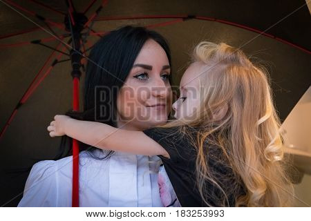 Girl And Mom In Exhibition Hall For Car