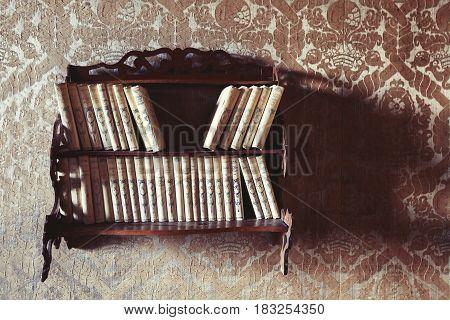 VIGNANELLO, ITALY. November 17, 2015: Library vintage inside the Castello (castle) Ruspoli, 16th-century castle, in the town of Vignanello, Lazio, Italy. Wall with wallpaper. Home of 1800, interior art.