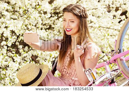 Selfie Time. Portrait Of Smiling Beautiful And Young Long-haired Girl In Pink Dress Taking Selfie On
