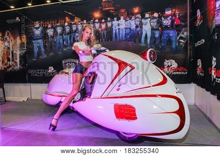 St. Petersburg Russia - 15 April, The girl behind the wheel of a moto-concept,15 April, 2017. International Motor Show IMIS-2017 in Expoforurum. Models on motorcycles presented at the motor show.