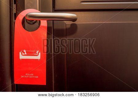 Do not disturb sign hanging on door knob