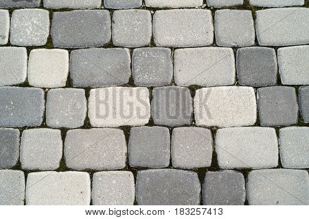 Texture of road surface made grey pave stones