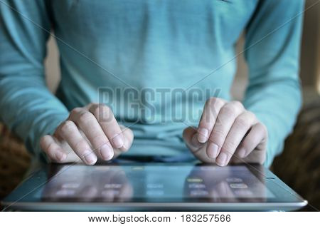 Person typing on tablet connecting communications on the internet