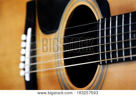 Closeup of guital strings for music playing songs