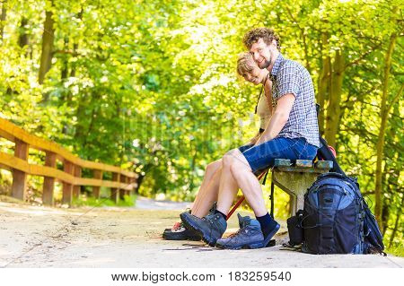 Hiker Young Couple With Backpack In Nature