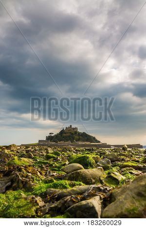 The receding tide exposes the causeway to St Michaels Mount, an iconic Cornwall landmark