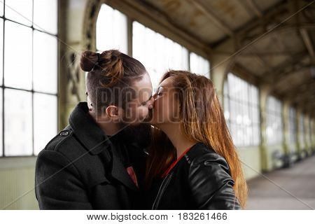 Hot kiss of two lovers. Man keep love for his girlfriend. Girl meet her husband on railway station. Happiness in the air. Attractive hipster family meeting. Woman take together her guy from train.