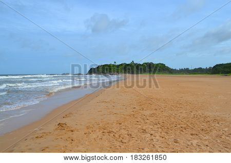 Indian ocean with golden sand, Bentota, Sri Lanka. A wonderful nature landscape of a beach scene