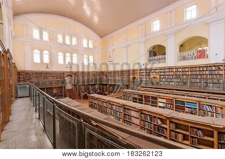 BANGALORE, INDIA - FEB 12, 2017: Interior of the Karnataka State Central Library Street with vintage bookshelves on February 12, 2017. Established in 1915 and housed with 2.500.000 books and rare volumes