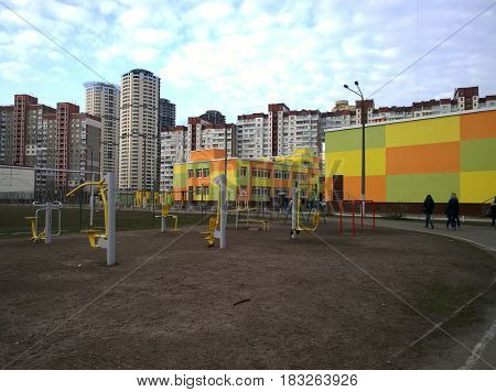 High residential buildings a school and a children's playground in Kiev in Ukraine
