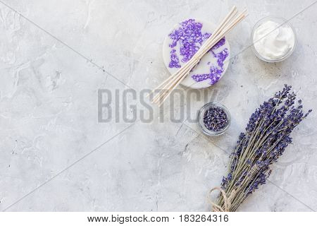 natural herb cosmetic with lavender flowers flatlay on stone table background top view mockup