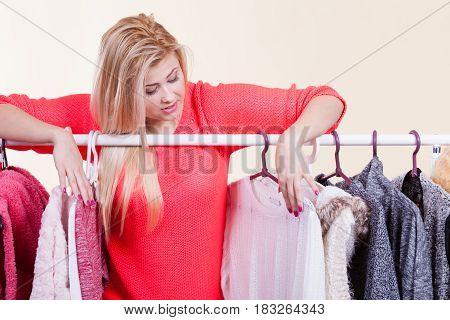 Woman In Winter Wardrobe Deciding What Wear