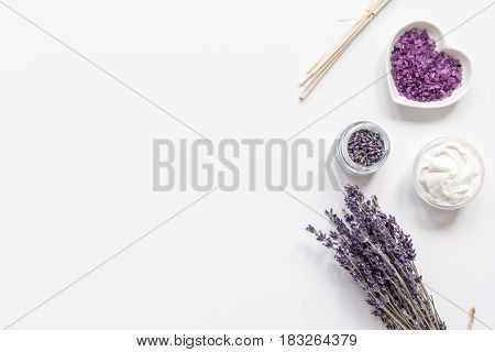 lavender flowers in organic cosmetic set with herbs on white table background top view mock-up