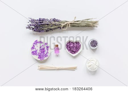 organic cosmetic with lavender oil for spa on white table background top view mock up