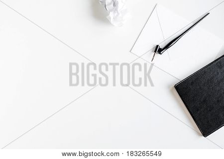 professional writer workplace with tools on white desk background top view mockup