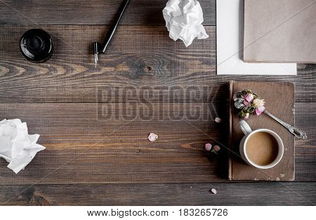professional writer workplace with tools and cup of coffee on wooden desk background top view mockup