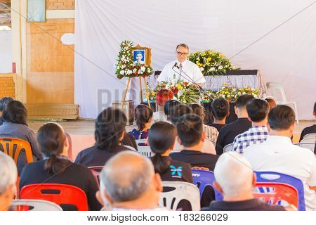 CHIANG RAI THAILAND - APRIL 19 : unidentified asian pastor preaching in front of people in Christian funeral on April 19 2017 in Chiang rai Thailand.