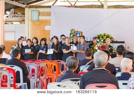 CHIANG RAI THAILAND - APRIL 19 : unidentified asian people singing in thai traditional Christian funeral on April 19 2017 in Chiang rai Thailand.