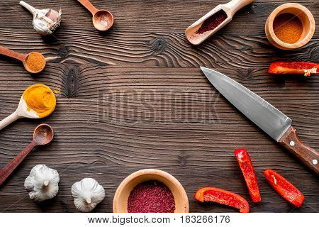 cooking tools, cut vegetables, pepper and garlic and spices in restaurant concept on wooden table background top view mock up