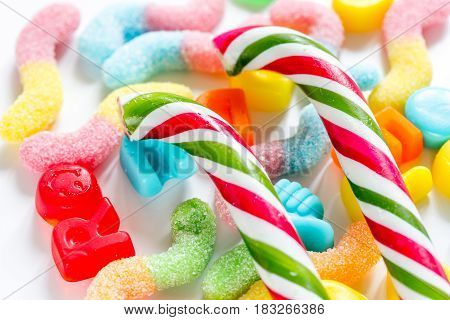 Delicious spiral sugar lollipops and candys on abstract candy background pattern