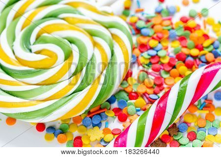 colorful lollipop design with sugar candys on sweet texure abstract background